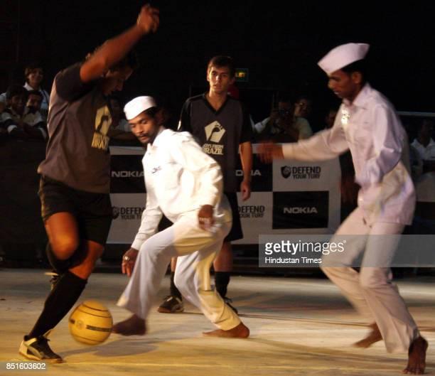 Dabbawala Mumbai Dabbawalas play a football match 'defend your turf' with boys from Brazil in Mumbai