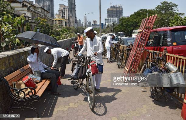 Dabbawalas sorting Dabbas to deliver the lunches to the workplace at Lower Parel on April 17 2017 in Mumbai India Dabbawala is a person in India most...