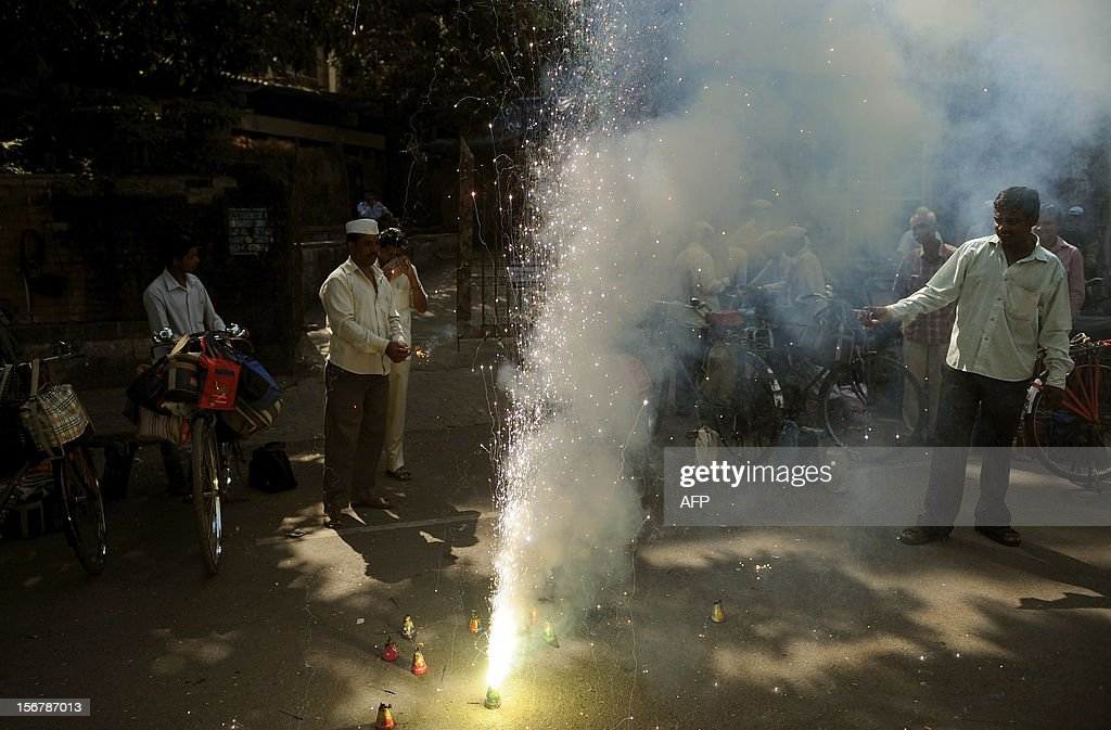Dabba-wallas or lunchbox deliverers burn fire crackers to celebrate the execution of Pakistan-born Mohammed Kasab, the sole surviving gunman of the 2008 Mumbai attacks, in Mumbai on November 21, 2012. Kasab, the sole surviving gunman from the 2008 Mumbai attacks was executed on November 21 to the relief of survivors and victims' families, nearly four years after 166 people died in the three-day rampage.