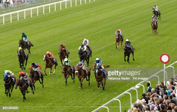 Dabbers Ridge and jockey Michael Hills wins The totesport International Stakes at Ascot racecourse