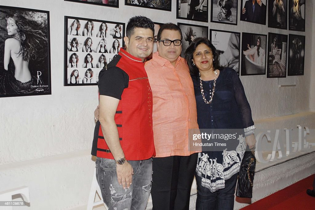 Dabboo Ratnani, <a gi-track='captionPersonalityLinkClicked' href=/galleries/search?phrase=Ramesh+Taurani&family=editorial&specificpeople=6136061 ng-click='$event.stopPropagation()'>Ramesh Taurani</a> and Varsha Taurani during the launch of Fashion photographer Dabboo Ratnani's 2015 calendar on January 5, 2015in Mumbai, India.