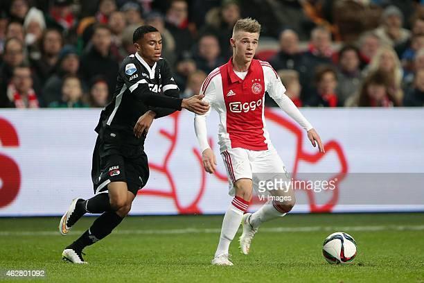 Dabney Dos Santos of AZ Alkmaar Daley Sinkgraven of Ajax during the Dutch Eredivisie match between Ajax Amsterdam and AZ Alkmaar at the Amsterdam...