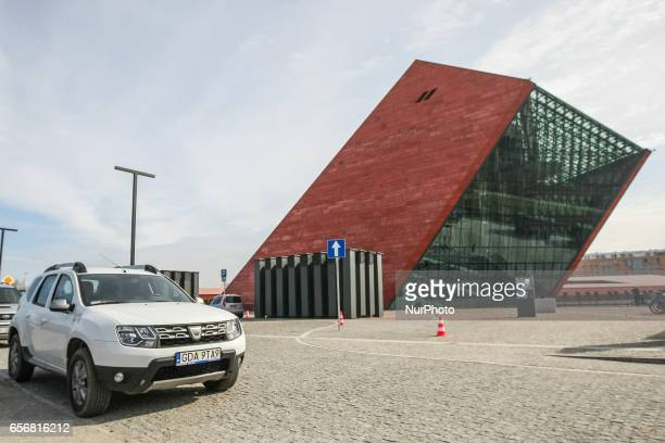 Dacia Duster in front of Second World War Museum building is seen on 23 March 2017 in Gdansk Poland World War II Museum the biggest of its kind in...