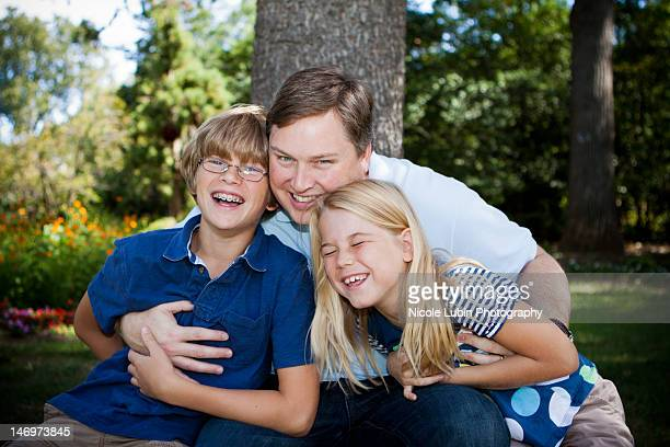 Dad and children laughing together