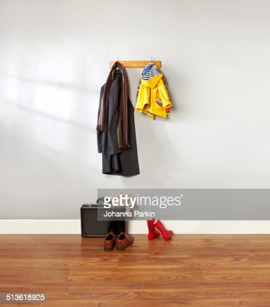 Dad and child's coat hanging up in hallway