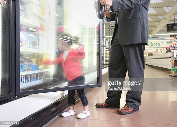 Dad and daughter at grocery store.