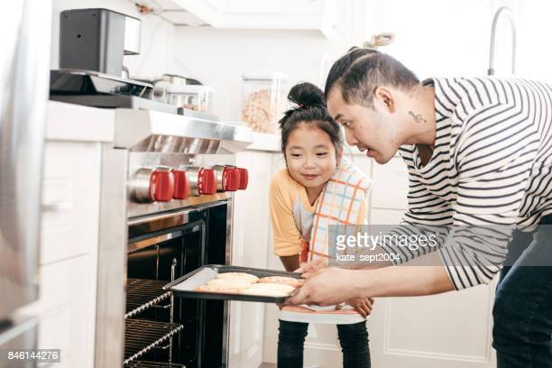 Dad and daughter baking in the kitchen