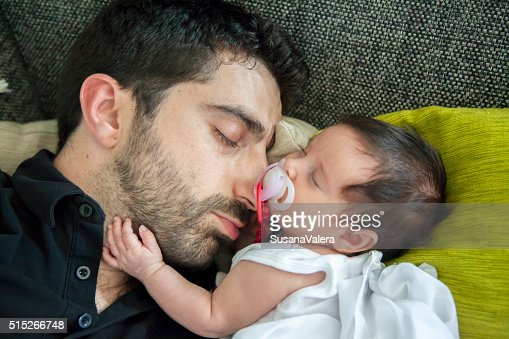 Dad and daughter having a nap together. : Stock Photo