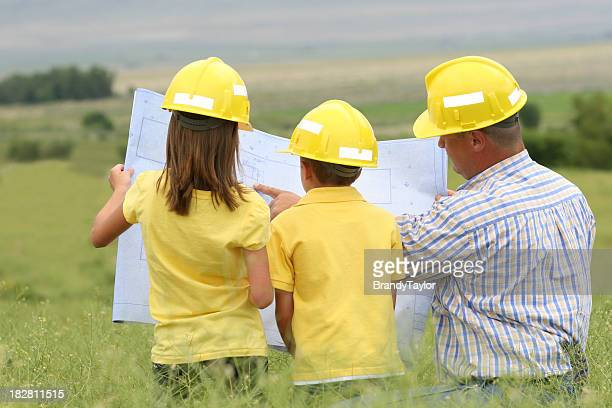 Dad and Kids Planning their Dream House