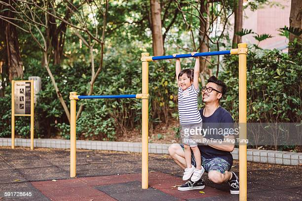 Dad and little daughter doing exercise joyfully