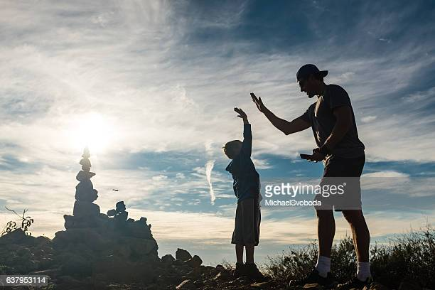 Dad And Son At Top Of Their Hike Celebrating