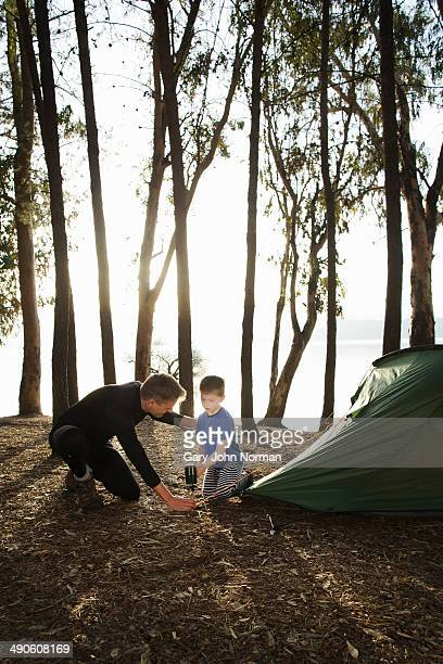 Dad and son putting up tent