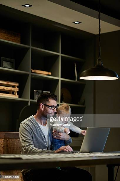 Dad and son with laptop