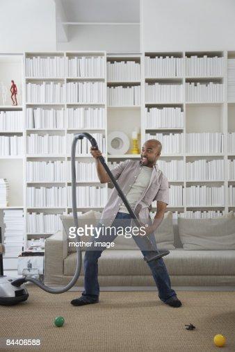 Dad doing housework. : Stock Photo
