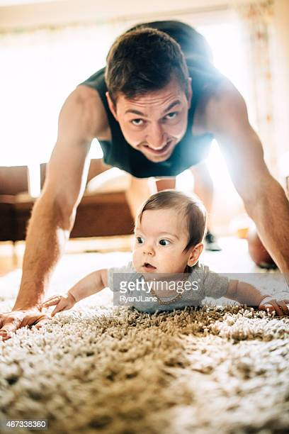 Dad Exercising with Infant Son