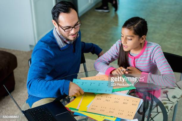 Dad helps daughter with math homework
