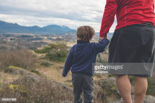 Dad hiking with young son