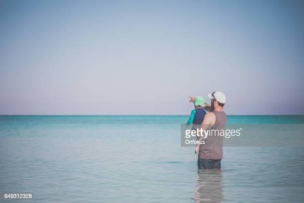 Dad Holding Baby Boy at Beach, Cuba