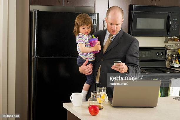 Dad holding daughter as he prepares to start the day