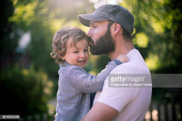 dad kisses son