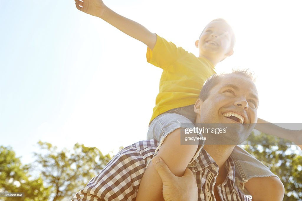 Dad makes me feel like I can fly : Stock Photo