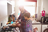 Dad making lunch for his children