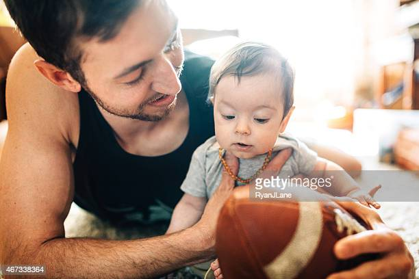 Dad Playing with Infant Son