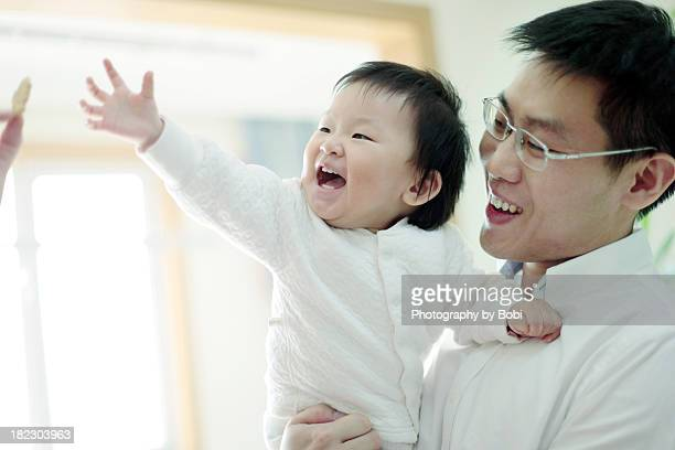 Dad playing with the little baby