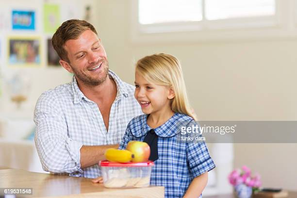 Dad preparing daughter for school