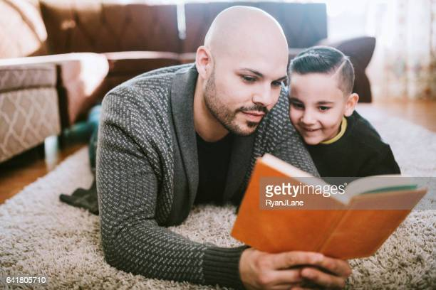 Dad Reading to Son in Living Room