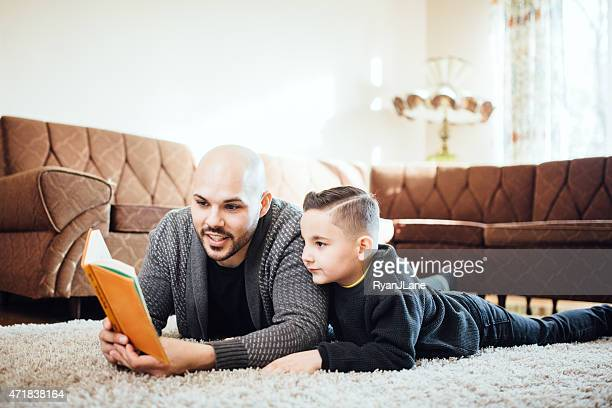 Dad Reading with Son in Living Room