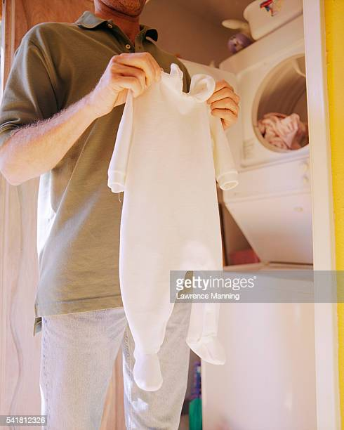 Dad Removing Baby Clothes from Dryer