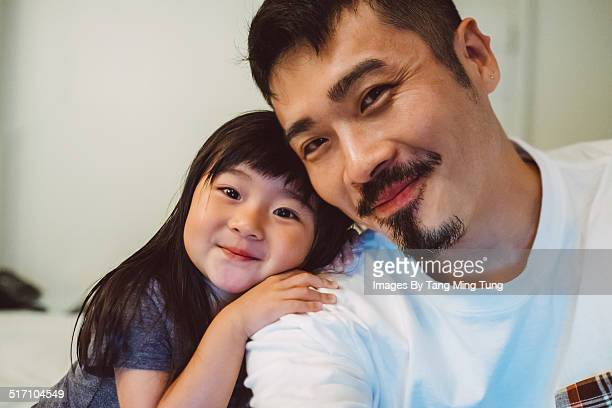 Dad taking selfie with lovely toddler joyfully