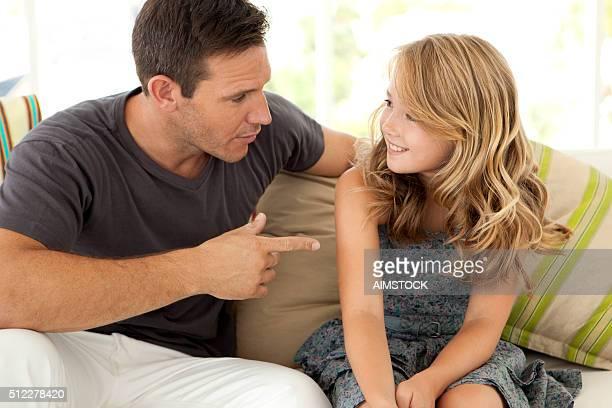 Dad talking to his daughter