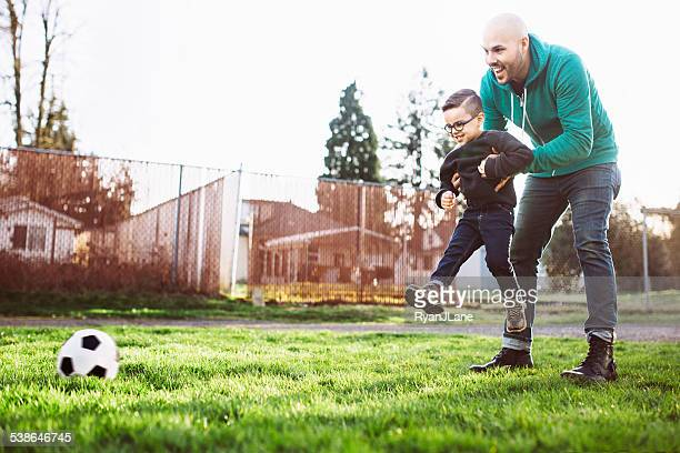 Dad Teaching Son to Play Soccer