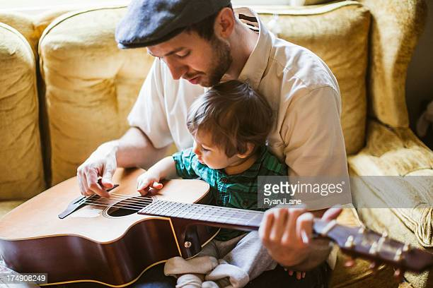 Dad Teaching Toddler to Play Instrument