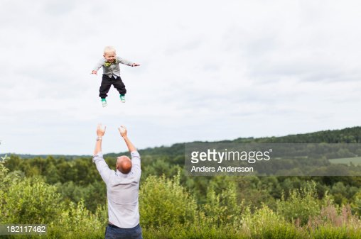 Dad throwing child into air