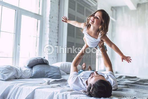 Dad with daughter at home : Stock Photo