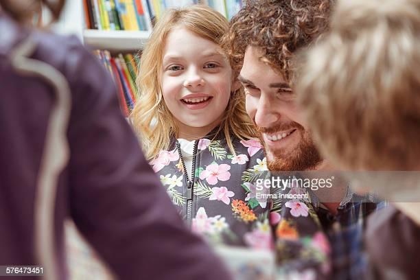 dad with daughter inside children bookshop