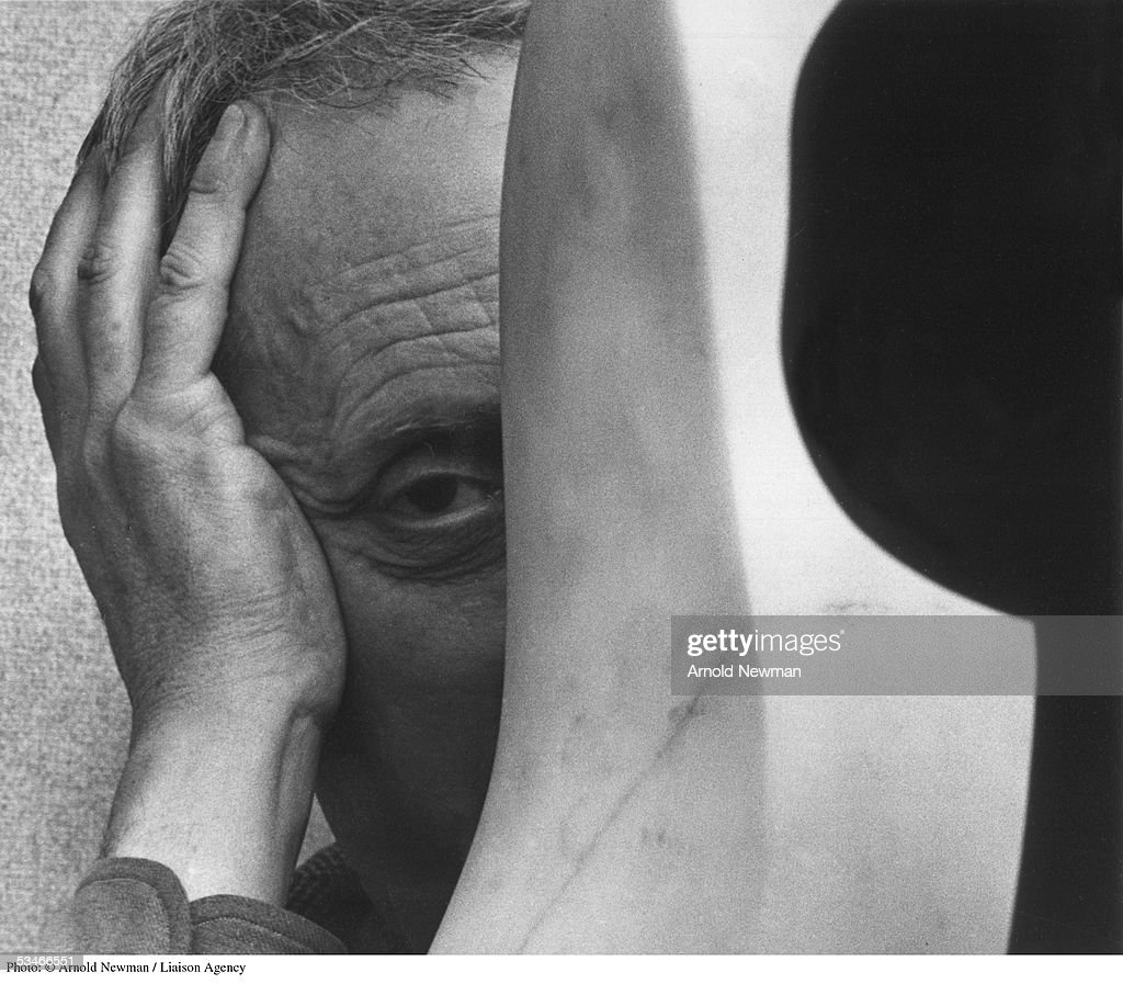 Dadaist sculptor Jean Arp poses for portrait with sculpture January 31, 1949 in New York City.