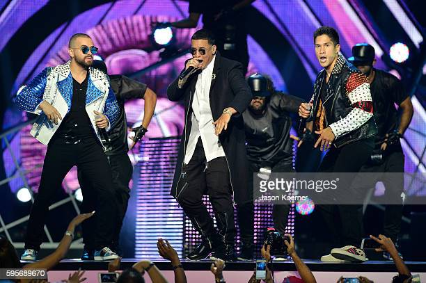 Daddy Yankee and Chino Nacho onstage at Telemundo's Premios Tu Mundo 'Your World' Awards at American Airlines Arena on August 25 2016 in Miami Florida