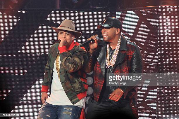 Daddy Yankee and Don Omar perform as part of their concert 'The Kingdom Daddy Yankee vs Don Omar' at Coliseo Jose M Agrelot on December 4 2015 in San...