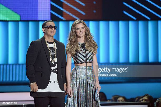 Daddy Yankee and Maritza Rodríguez speak onstage at Telemundo's 'Premios Tu Mundo' Awards 2015 at American Airlines Arena on August 20 2015 in Miami...