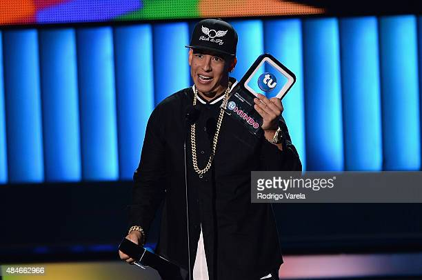 Daddy Yankee received an award onstage at Telemundo's 'Premios Tu Mundo' Awards 2015 at American Airlines Arena on August 20 2015 in Miami Florida