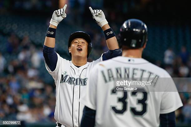 DaeHo Lee of the Seattle Mariners celebrates as he crosses home plate after hitting a threerun home run against the Tampa Bay Rays in the fourth...