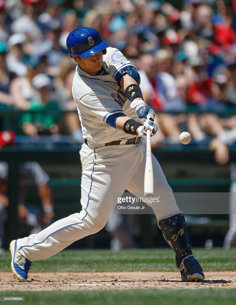 Dae-Ho Lee #10 of the Seattle Mariners doubles in the second inning against the St. Louis Cardinals at Safeco Field on June 26, 2016 in Seattle, Washington.