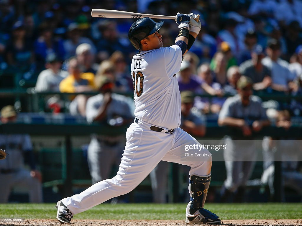 Dae-Ho Lee #10 of the Seattle Mariners hits a three-run home run against the San Diego Padres in the eighth inning at Safeco Field on May 30, 2016 in Seattle, Washington.