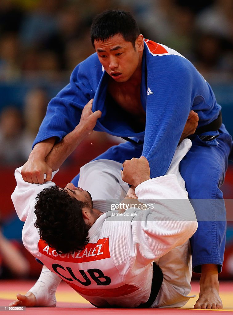 Dae-Nam Song of Korea (blue) competes with <a gi-track='captionPersonalityLinkClicked' href=/galleries/search?phrase=Asley+Gonzalez&family=editorial&specificpeople=5489206 ng-click='$event.stopPropagation()'>Asley Gonzalez</a> Montero of Cuba during the Men's -90 kg Judo on Day 5 of the London 2012 Olympic Games at ExCeL on August 1, 2012 in London, England.