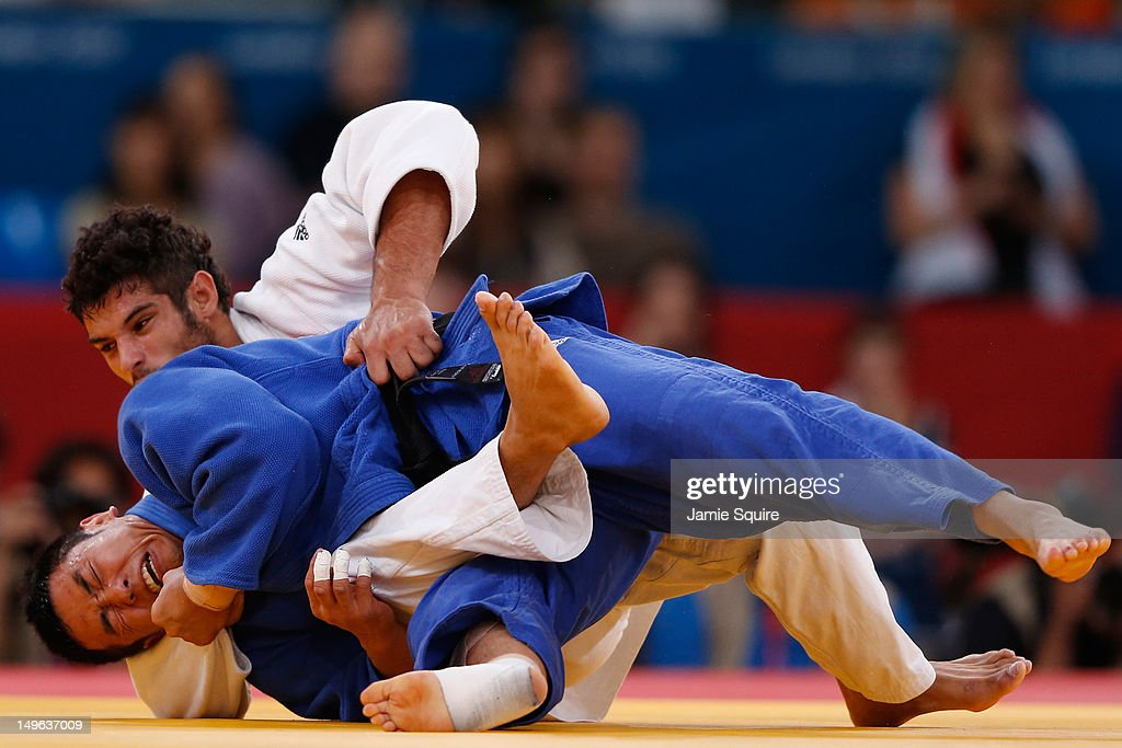 Dae-Nam Song of Korea (blue) competes with Asley Gonzalez Montero of Cuba during the Men's -90 kg Judo on Day 5 of the London 2012 Olympic Games at ExCeL on August 1, 2012 in London, England.