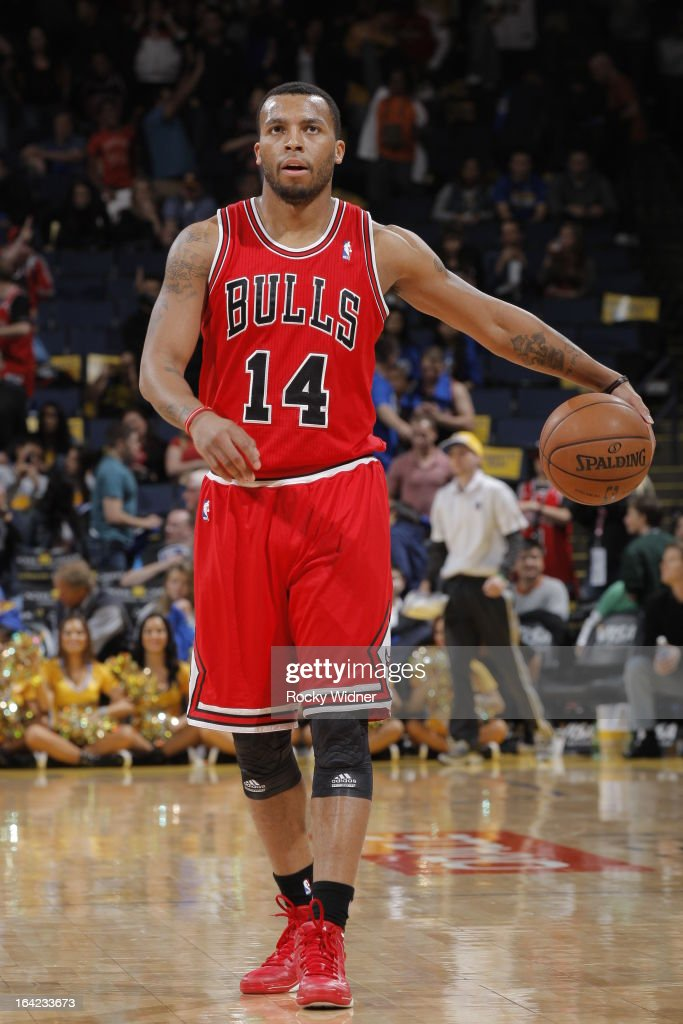 <a gi-track='captionPersonalityLinkClicked' href=/galleries/search?phrase=Daequan+Cook&family=editorial&specificpeople=3847493 ng-click='$event.stopPropagation()'>Daequan Cook</a> #14 of the Chicago Bulls dribbles against the Golden State Warriors on March 15, 2013 at Oracle Arena in Oakland, California.